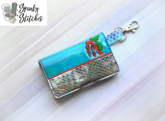 Ariel Mermaid mini wallet key fob in the hoop embroidery file by spunky stiches