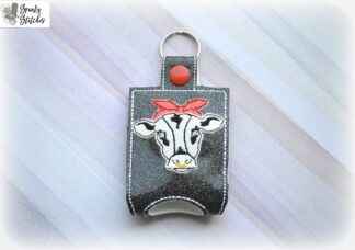 Heifer with bandana handsanitizer case key fob in the hoop embroidery file by spunky stitches