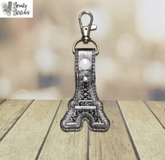 eiffel tower key fob in the hoop embroidery design by spunky stitches