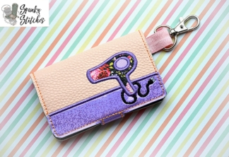 hair dryer mini wallet key fob in the hoop embroidery design by spunky stitches