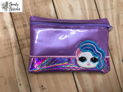 Lol Doll zipper bag in the hoop embroidery design by spunky stitches