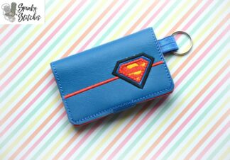 superman mini zipper wallet key fob in the hoop embroidery file by spunky stitches