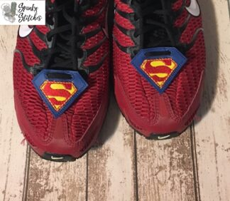 superman shoe tags in the hoop embroidery file by spunky stitches