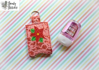 Poinsettia hand sanitizer key fob in the hoop embroidery file by spunky stitches